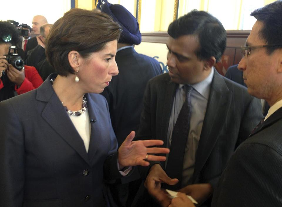 Rhode Island Governor Gina Raimondo and Infosys President Ravi Kumar spoke after a news conference in Providence on Monday.