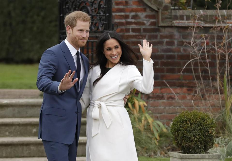 Britain's Prince Harry and his fiancee Meghan Markle posed for photographers during a photocall in the grounds of Kensington Palace in London on Monday.)