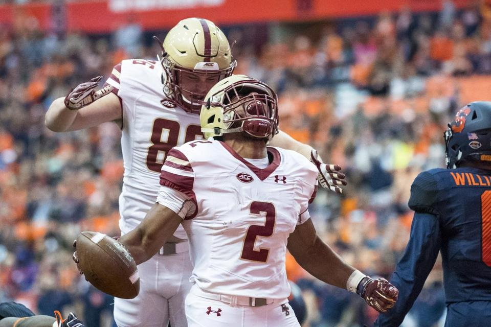 SYRACUSE, NY - NOVEMBER 25: AJ Dillon #2 of the Boston College Eagles celebrates a touchdown during the first quarter that makes the score 14-7 Boston College leading Syracuse Orange at the Carrier Dome on November 25, 2017 in Syracuse, New York. (Photo by Brett Carlsen/Getty Images)