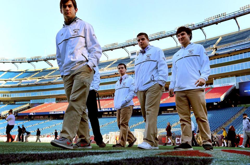 Foxboro-11/28/17-THe Millis High School footbal captains walk on to tht field at Gillette Stadium. Captains, coaches and cheerleaders form the high schools that will play in Friday, and Saturdays MIAA superbowls, got to see Gillette Stadium, where they will play the games. John Tlumacki/Globe Staff(sports)