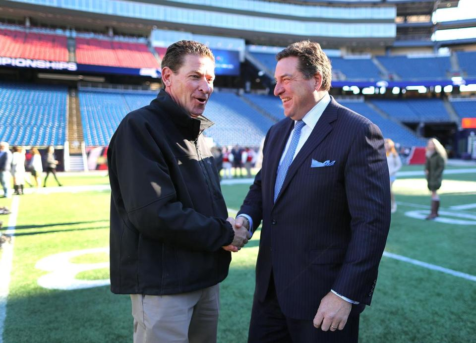 Foxboro-11/28/17-North Attleborough High School football coach Don Johnson(left) shakes hands with St. John's Shrewsbury football coach John Adreoi in Gillette Stadium. They were teammates at Holy Cross. Captains, coaches and cheerleaders form the high schools that will play in Friday, and Saturdays MIAA superbowls, got to see Gillette Stadium, where they will play the games. John Tlumacki/Globe Staff(sports)
