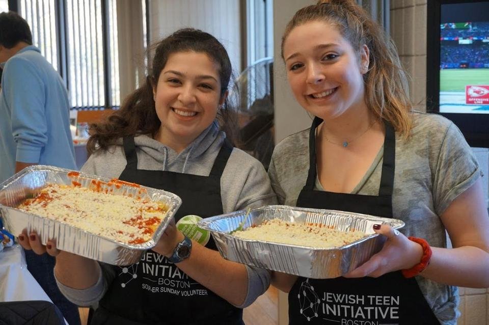 03nosoupersunday - Hannah Zimmerman (left) and Rebecca Dunn, both 17 and from Peabody, worked a lasagna station during Soup-er Sunday. (Handout)