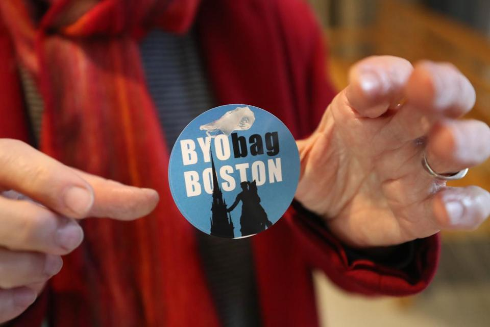 Gretchen Dietz of West Roxbury held a sticker in favor of Boston's proposed plastic bag ban.