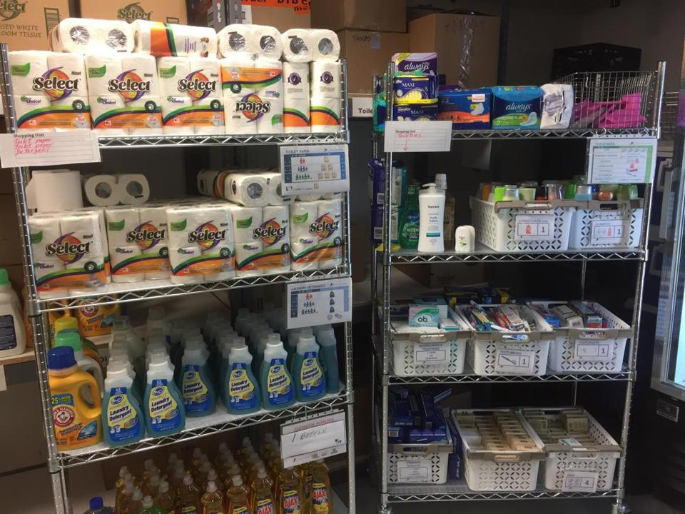 The Newton Food Pantry stocks its shelves with household cleaning and personal hygene products.