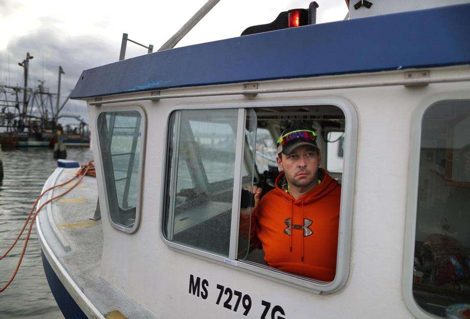 Lobsterman Tom Tomkiewicz, on his boat at Union Wharf in Fairhaven, said he is trapping in deeper, colder waters.