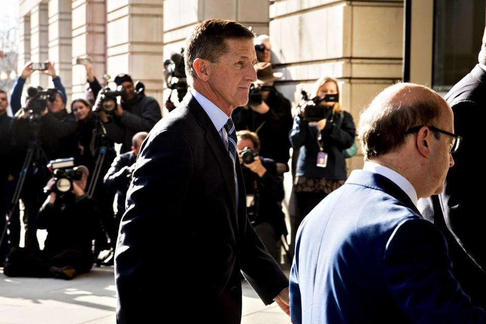 Michael Flynn, former U.S. national security adviser, left, arrives at the U.S. Courthouse in Washington on Friday. Flynn pleaded guilty Friday morning to lying to federal agents regarding contacts with Russian officials. MUST CREDIT: Bloomberg photo by Andrew Harrer