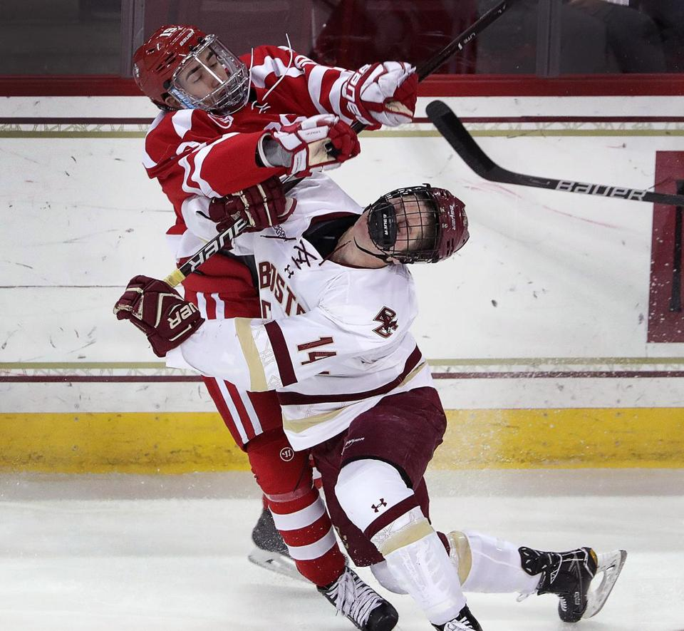 BU's Hank Crone (19) delivered a heavy hit to BC's Zach Walker in the first period.