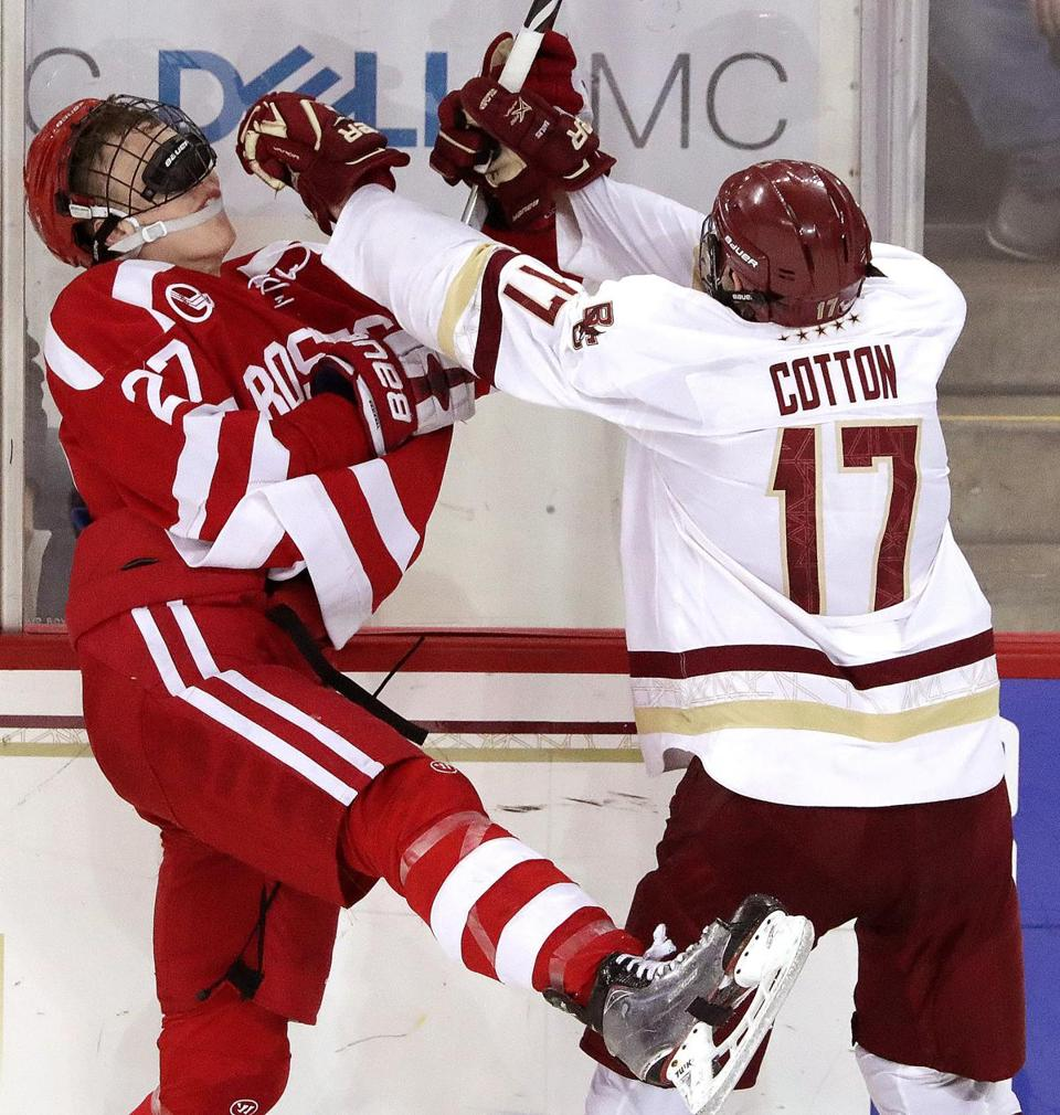 BU's Brady Tkachuk (27) and BC's David Cotton collided in the second period.