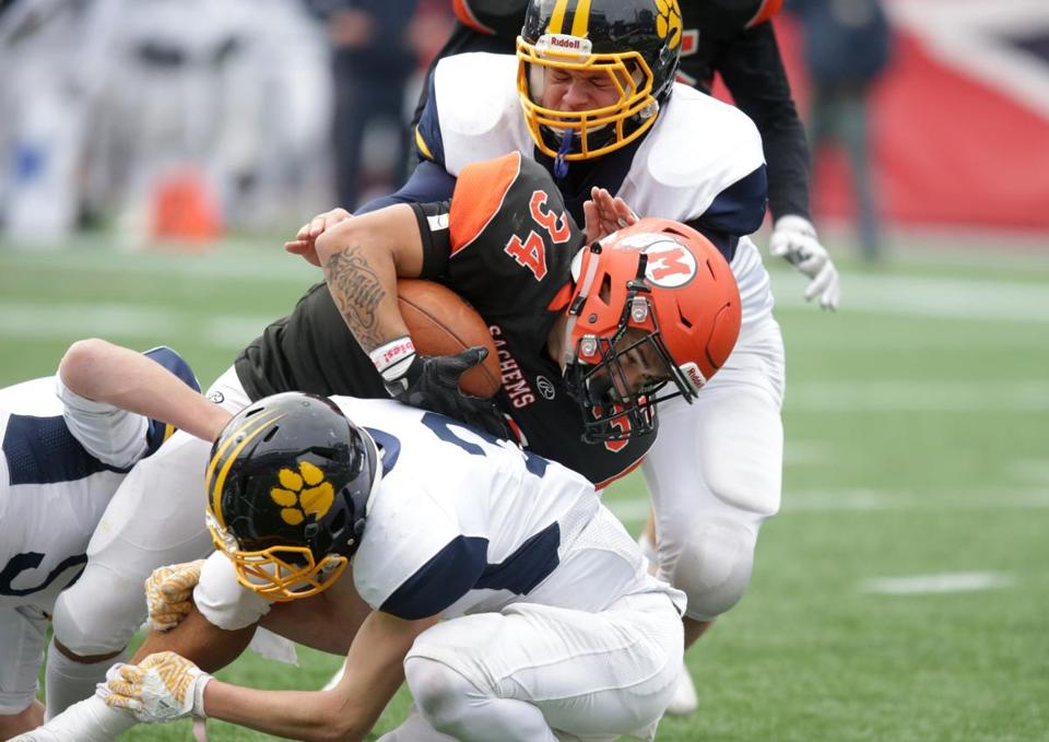 It takes two Littleton defenders to bring down Middleborough's Jeremy Soule in the fourth quarter Saturday in the Division 6 Super Bowl.