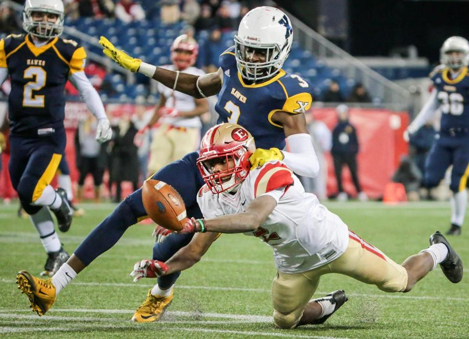 Jason Maitre just misses reeling in a pass as Xaverian's Brian Abraham defends at Gillette Stadium.