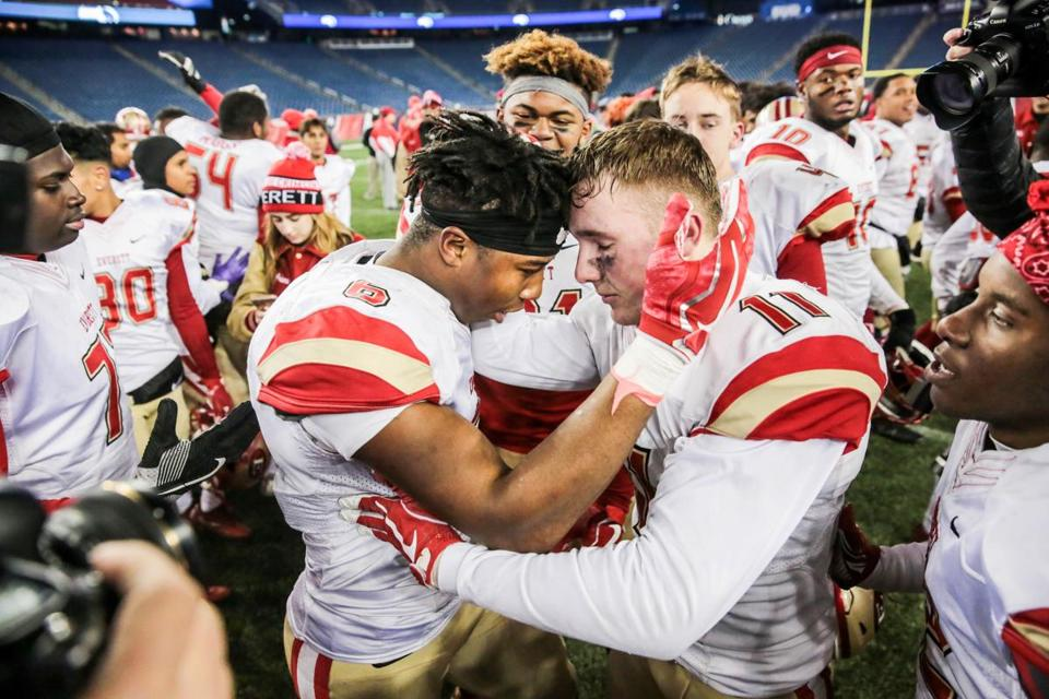 Everett's Kevin Brown (left) and Anthony Norcia share a moment after their victory in the Division 1 Super Bowl at Gillette Stadium.
