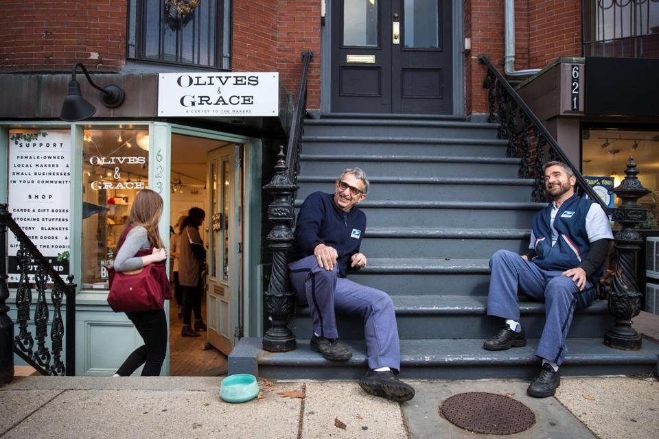 Kostaras (left) and Giordano rested on a stoop outside Olives and Grace. Business owners from across the country have asked them to review products.