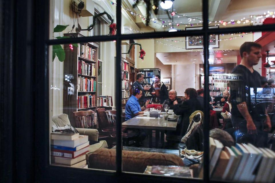 "Viewed from outside, published and aspiring authors converse at the Book and Bar ""Writers Night Out'' event in Portsmouth, NH."