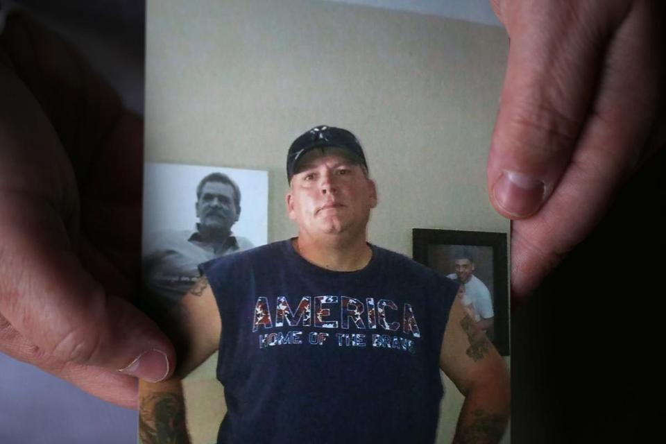 Tammy Roberts held a photo of her husband, Michael, who is one of the missing crewmembers.