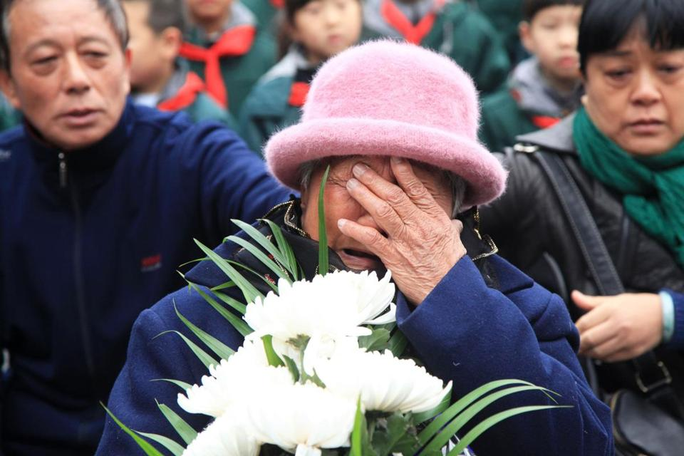 A survivor cries during a memorial ceremony at the Memorial Hall of the Victims in Nanjing Massacre by Japanese Invaders ahead of China's National Memorial Day for Nanjing massacre victims in Nanjing city, east China's Jiangsu province on December 4, 2017. China's National Memorial Day marks on December 13 the 80th anniversary of the 1937 Nanjing massacre by Japanese troops. / AFP PHOTO / - / China OUT-/AFP/Getty Images