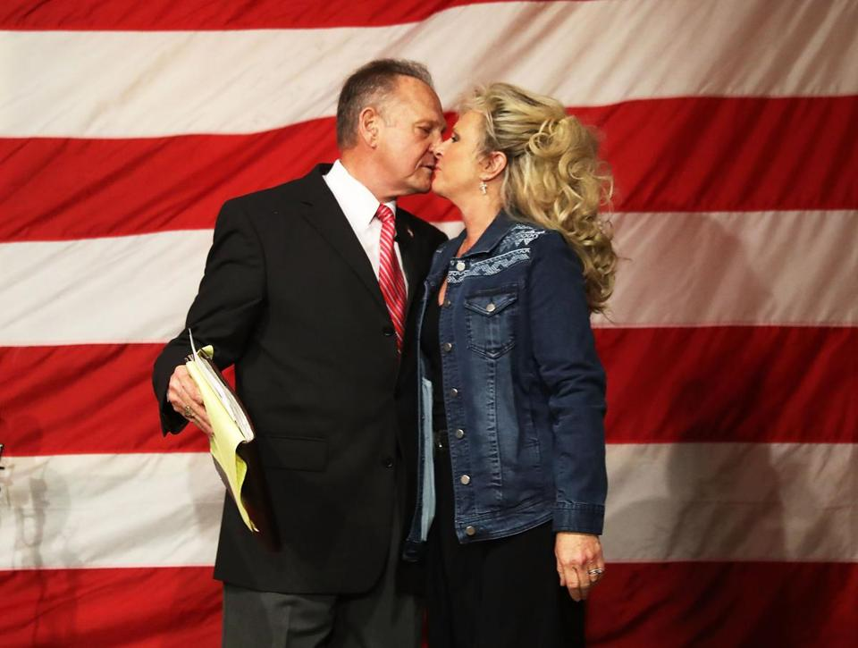 Roy Moore kissed his wife Kayla Moore during a campaign event at Oak Hollow Farm.