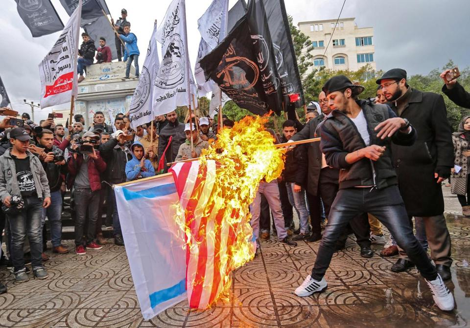Palestinian protesters burned US and Israeli flags in Gaza City Wednesday after President Trump's address.