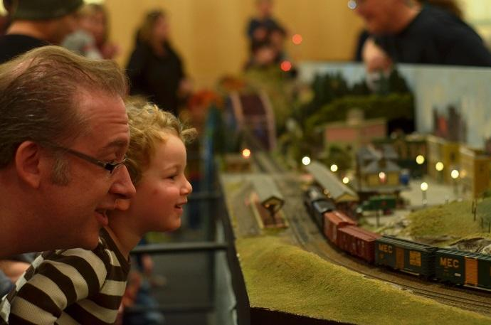 Father and son, Jeff and Jakob Croteau, admire a model railroad at the Scottish Rite Masonic Museum and Library.
