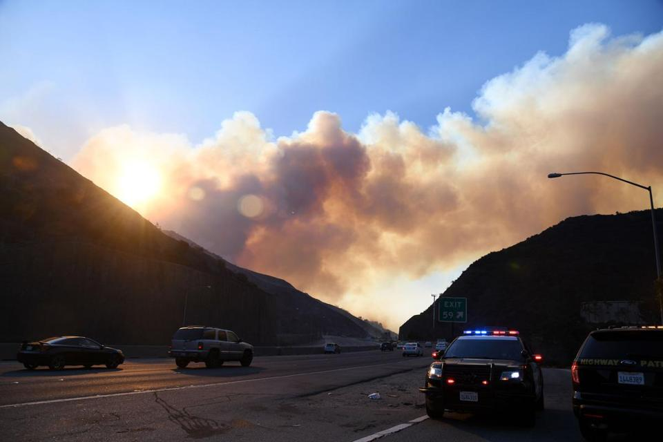 Smoke from the Skirball Fire rises above the 405 Freeway on Wednesday.