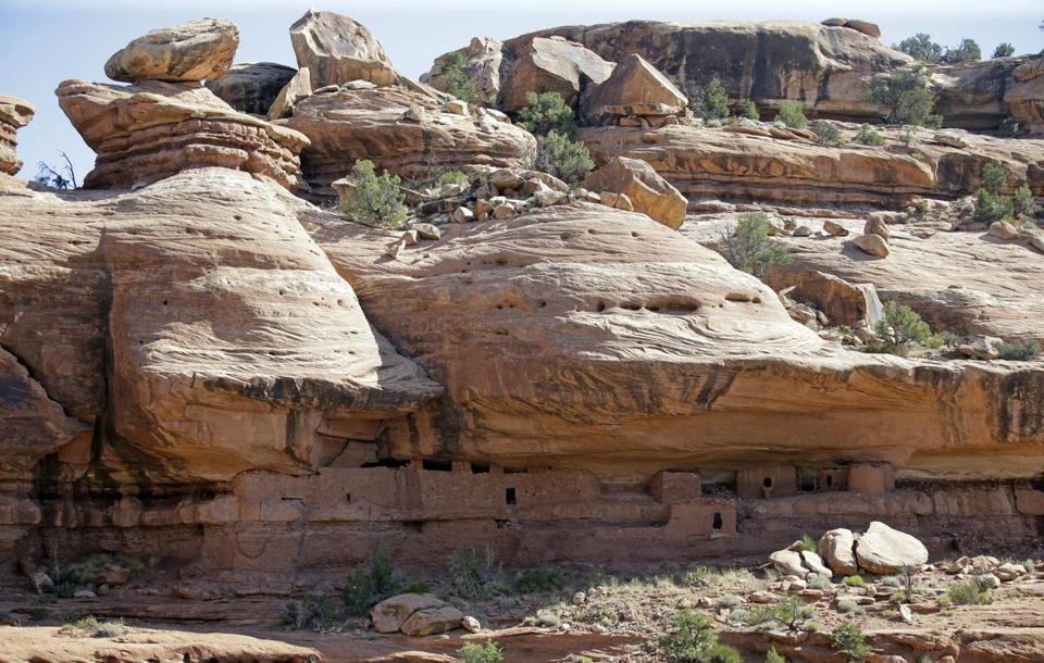 "FILE - This July 15, 2016, file photo, shows the ""Moonhouse"" in McLoyd Canyon which is part of Bears Ears National Monument, near Blanding, Utah. President Donald Trump is expected to announce plans to shrink Bears Ears National Monument as well as Grand Staircase-Escalante National Monument in Utah that were created by past Democratic presidents. (AP Photo/Rick Bowmer, File)"