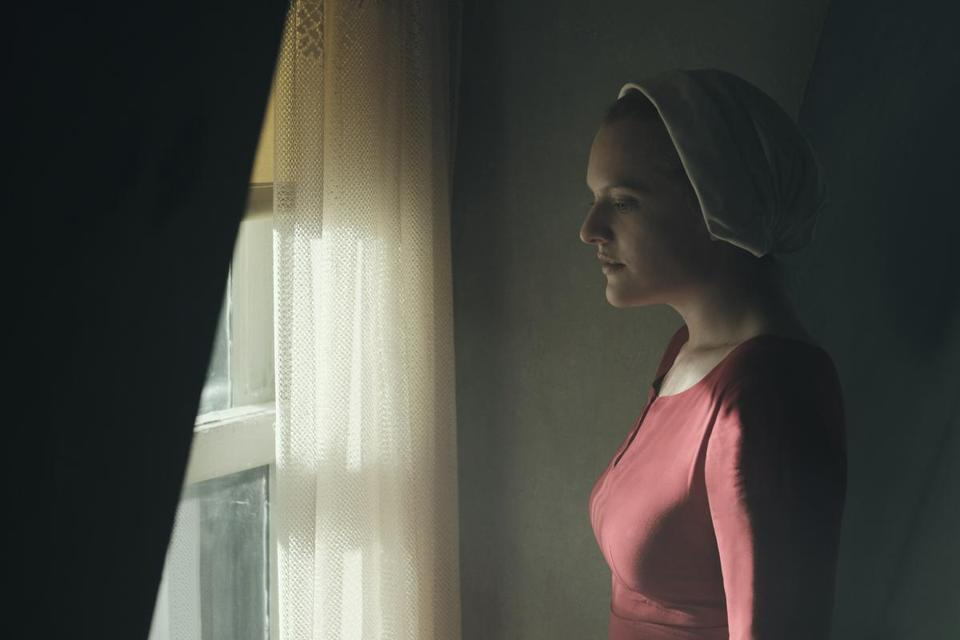 "Elisabeth Moss stars as Offred in ""The Handmaid's Tale."""
