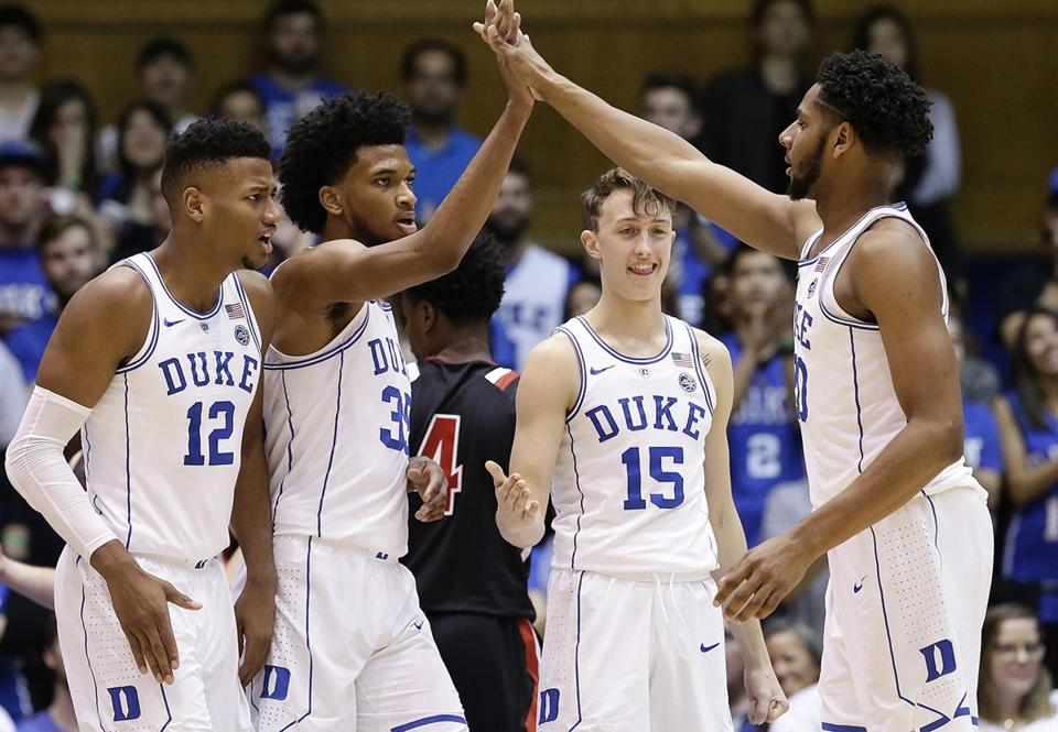 Duke's Javin DeLaurier (12), Marvin Bagley III (35), Alex O'Connell (15) and Marques Bolden react following a play during the second half of an NCAA college basketball game against Saint Francis (Pa.) in Durham, N.C., Tuesday, Dec. 5, 2017. Duke won 124-67. (AP Photo/Gerry Broome)