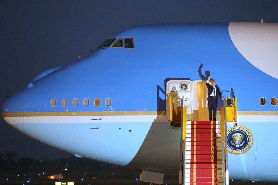 President Donald Trump waved from the door of the 'Air Force One' plane as he arrived at Noi Bai International Airport in Hanoi, Vietnam on Monday..