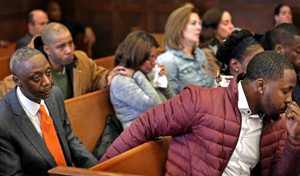 BOSTON, MA - 12/11/2017: Seated on the left, Ian Jaffier after giving his testimony about the murder of his daughter Dawn Jaffier in court is consoled with others in tears. First day of trial at Suffolk Superior Court in Boston for two men, Keith Williams and Wesson Colas accused of murder in the death of Dawn Jaffier at the J'ouvert Parade in 2014. (David L Ryan/Globe Staff ) SECTION: METRO TOPIC 12jaffier