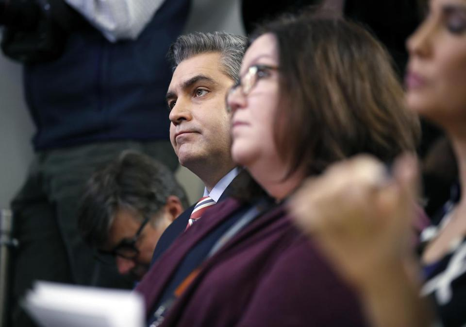 CNN's Jim Acosta, left, listens to White House press secretary Sarah Huckabee Sanders during a press briefing at the White House, Monday, Dec. 11, 2017, in Washington. (AP Photo/Alex Brandon)