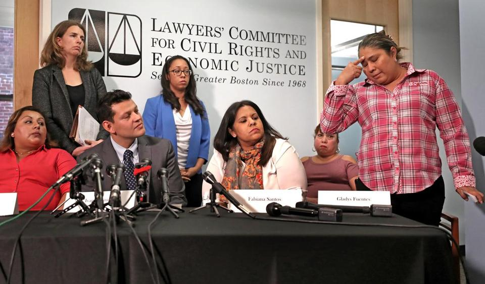 Attorneys Rachel Smit and Sophia Hall (from left, standing) and Ivan Espinoza of the Lawyers Committee for Civil Rights and Economic Justice joined the plaintiffs Tuesday.