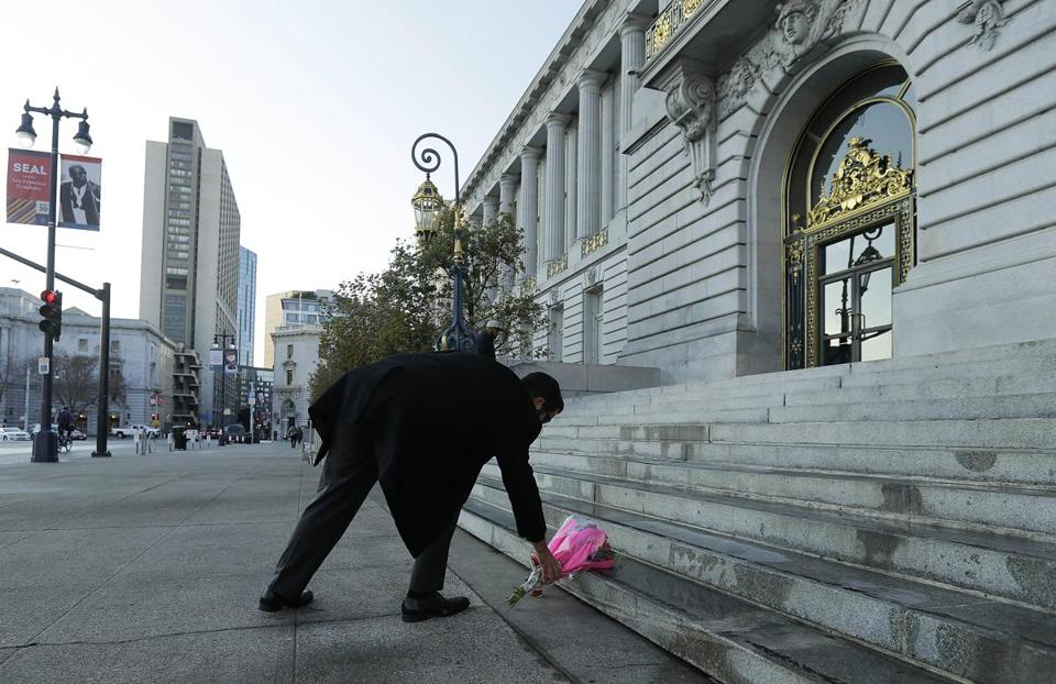 A man left flowers on the steps of San Francisco's City Hall after the mayor's death