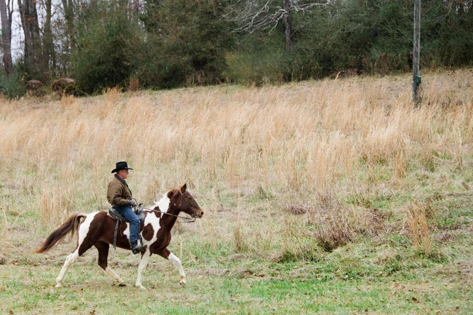 Roy Moore rides his horse, Sassy, to the polling station to vote in Gallant, Ala., on Tuesday.