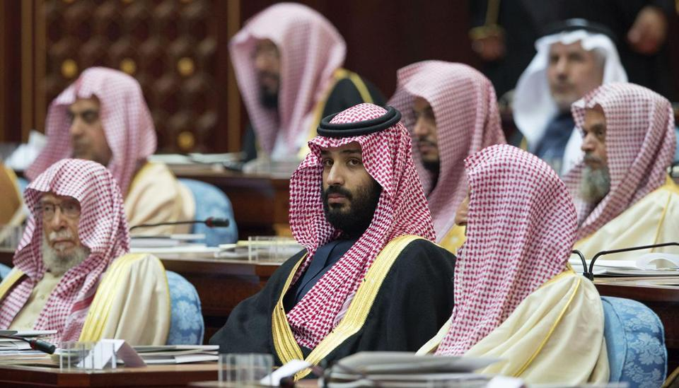 "A handout picture provided by the Saudi Royal Palace on December 13, 2017, shows Saudi Crown Prince and Defence Minister Mohammed bin Salman (C) attending the opening of the shura council ordinary session in Riyadh. / AFP PHOTO / Saudi Royal Palace / BANDAR AL-JALOUD / RESTRICTED TO EDITORIAL USE - MANDATORY CREDIT ""AFP PHOTO / SAUDI ROYAL PALACE / BANDAR AL-JALOUD"" - NO MARKETING - NO ADVERTISING CAMPAIGNS - DISTRIBUTED AS A SERVICE TO CLIENTSBANDAR AL-JALOUD/AFP/Getty Images"