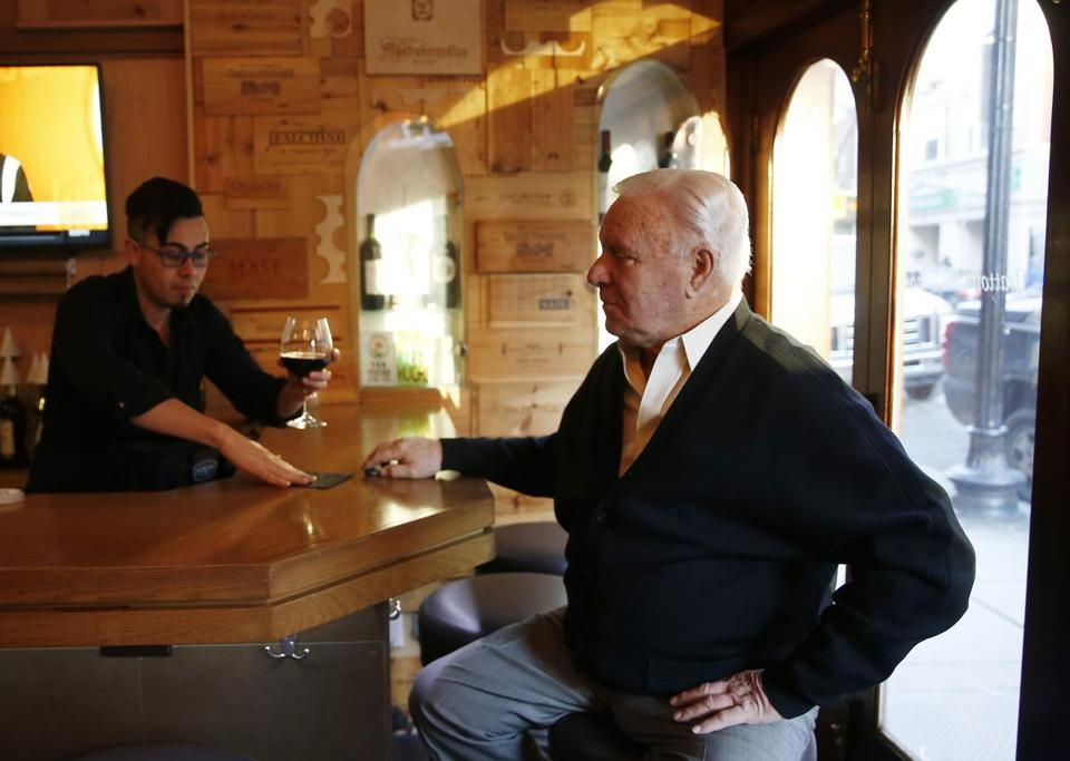 Bartender Leo Rodriguez serves Mike Tirella a glass of wine at Trattoria il Panino in the North End.
