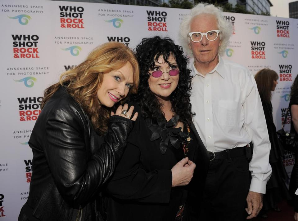 Photographer Bob Seidemann posed with Nancy and Ann Wilson of the band Heart at a photo exhibition in 2012 in Los Angeles.