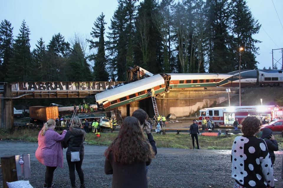 First responders worked at the scene of an Amtrak train that derailed near Seattle.