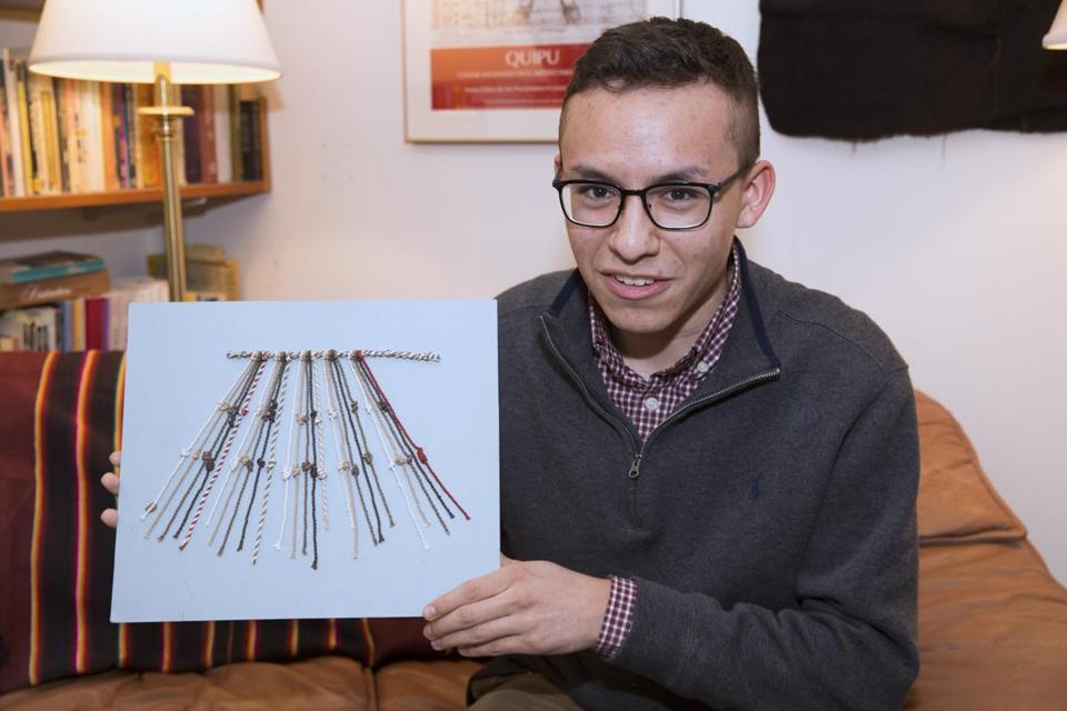 Manny Medrano '19 displays a model of quipus knots. Quipus are knots that Incas used to record censuses, etc., and there are only 1000 left in the world. Medrano is the first name on the paper he co-wrote with Professor Gary Urton, Dumbarton Oaks Professor of Pre-Columbian Studies, that is being published in EthnoJournal. Jon Chase/Harvard Staff Photographer