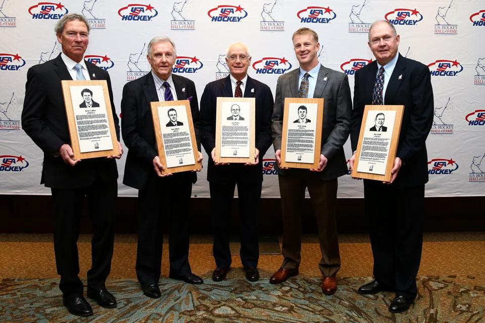 BOSTON, MA - DECEMBER 13: From left, Kevin Collins, Ron Wilson, Jack Parker, Scott Young, and Ben Smith stand with their plaques in before being inducted into the U.S. Hockey Hall of Fame at Westin Boston Waterfront Hotel on December 13, 2017 in Boston, Massachusetts.(Photo by Maddie Meyer/Getty Images)