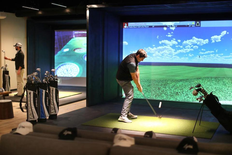 Mike Buckley, cofounder of Lynx, chipped the ball onto the green of the seventh fairway of Pebble Beach at one of three golf suites with golf course simulators.