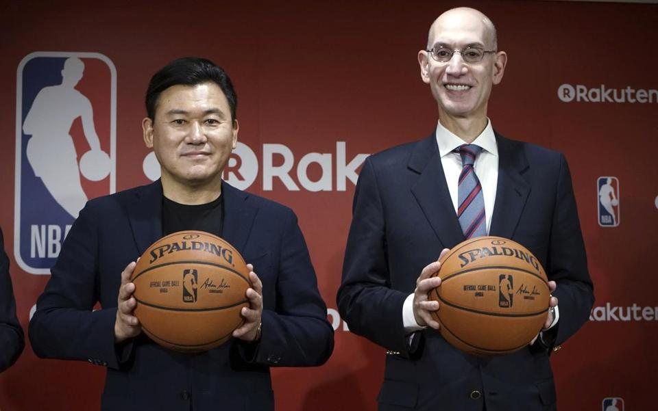 NBA Commissioner Adam Silver (right) posed with Rakuten Inc. chairman and chief executive Hiroshi Mikitani in Tokyo. The author argues such partnerships are good for the US.