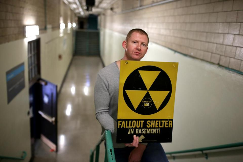 Colby said he has seen an uptick in traffic to his website, where he documents some of the fallout shelters that were in place in Boston. Above: Colby at the South Boston school that would have served as a fallout shelter.
