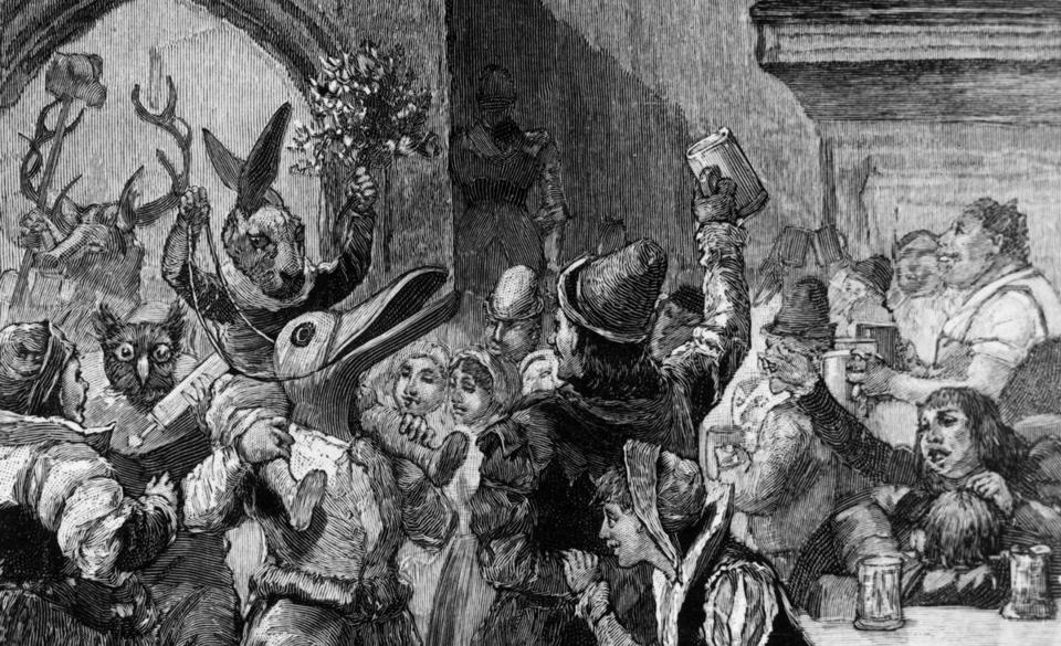 Circa 1500, A troupe of mummers in animal costumes performing in a Medieval Baronial Hall at Christmas. Original Publication: From 'Christmas in Olden Times' by Walter Scott. (Photo by Hulton Archive/Getty Images)
