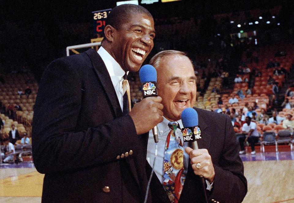Dick Enberg (right) with Lakers great Magic Johnson in 1992.