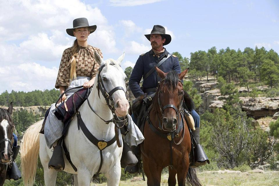 "Rosamund Pike and Christian Bale in Scott Cooper's ""Hostiles."""