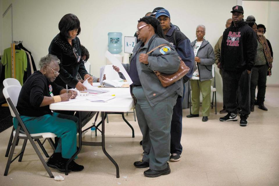 A voter inspected her ballot in Montgomery, Ala., on Dec. 12.