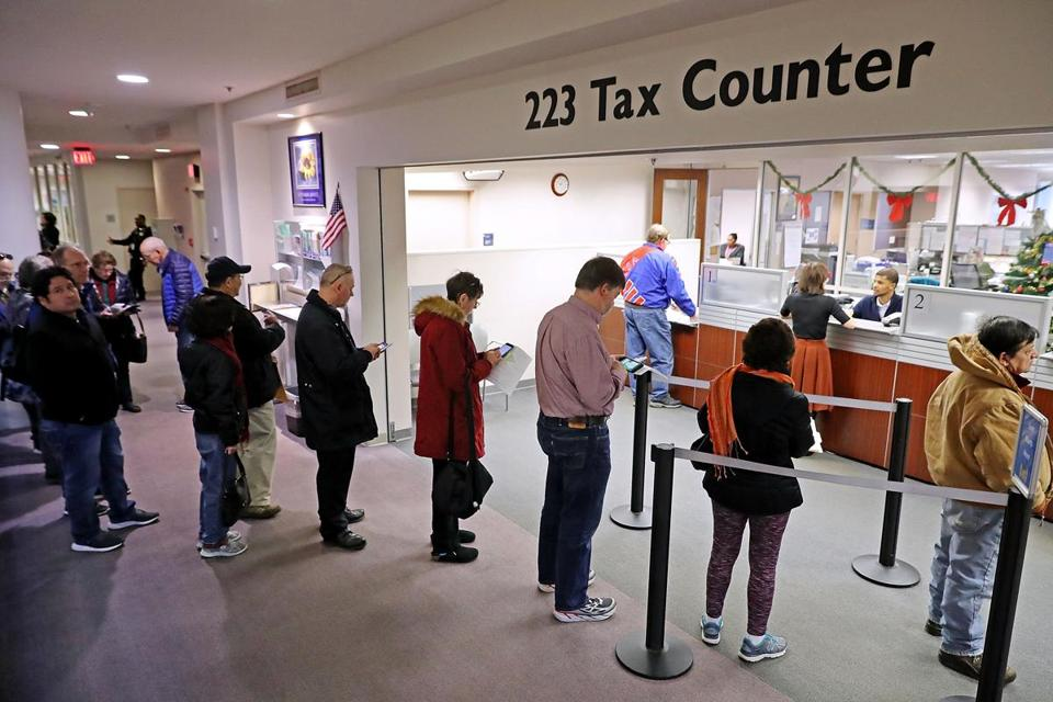 Residents waited in line to pay taxes at the Fairfax County Government Center Thursday in Fairfax, VA.