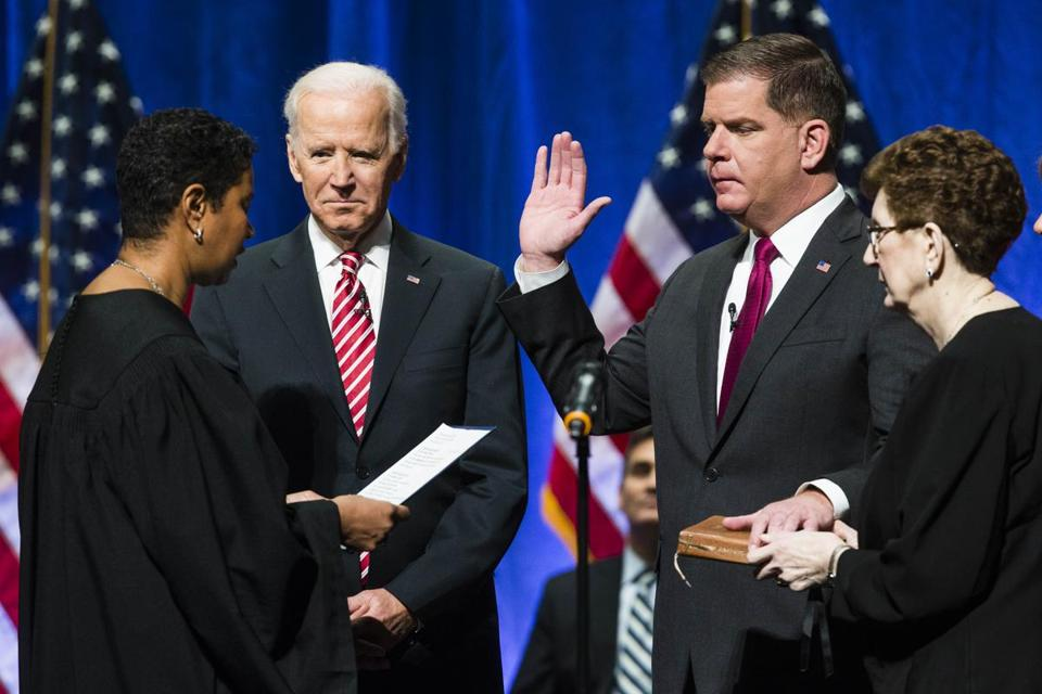Former vice president Joe Biden was a guest Monday to Walsh's swearing-in.