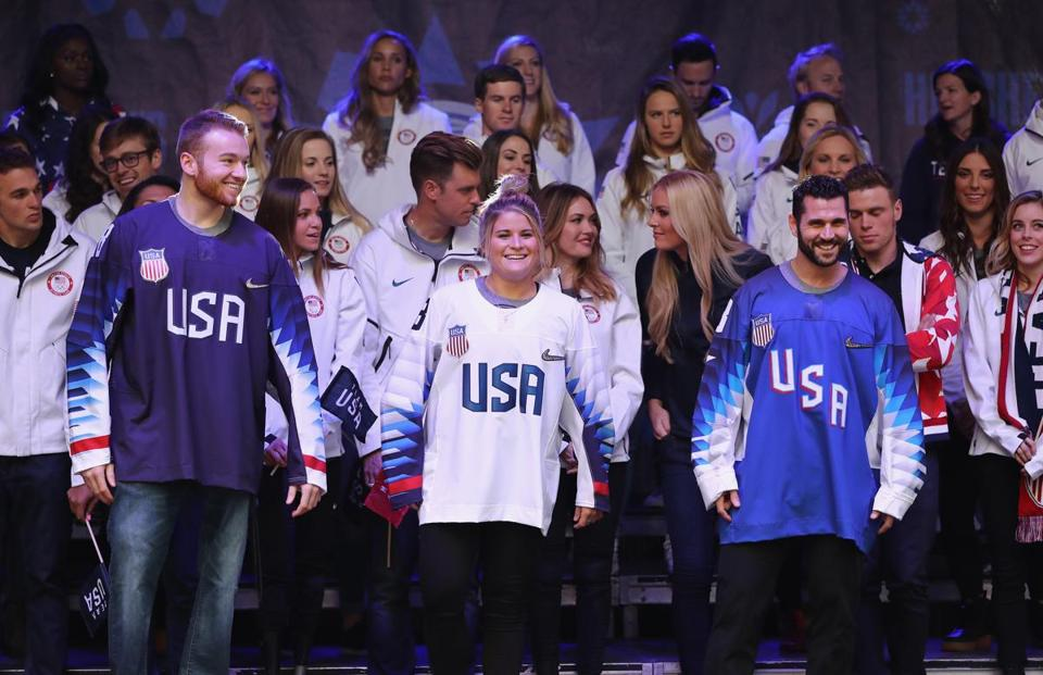 NEW YORK, NY - NOVEMBER 01: (L-R) Sled hockey player Declan Farmer and ice hockey players Brianna Decker and Brian Gionta attend the 100 Days Out 2018 PyeongChang Winter Olympics Celebration - Team USA in Times Square on November 1, 2017 in New York City. (Photo by Elsa/Getty Images for USOC)