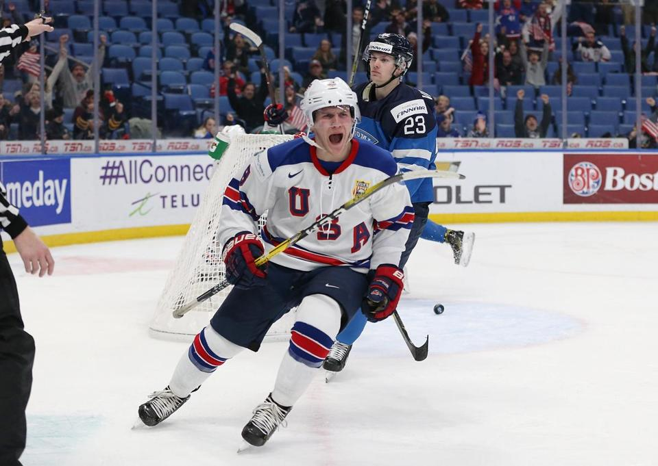 Adam Fox celebrates his third-period goal that lifted the US past Finland.