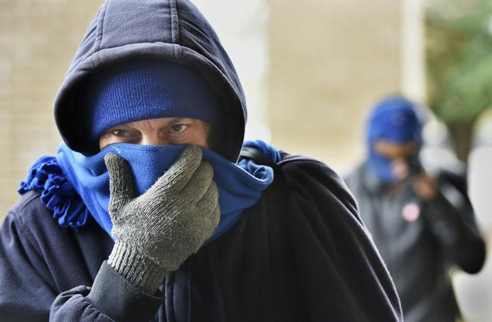 Chris McGuire tried to stay warm as he waited for a space at the City Rescue Mission on Tuesday in Jacksonville, Fla.
